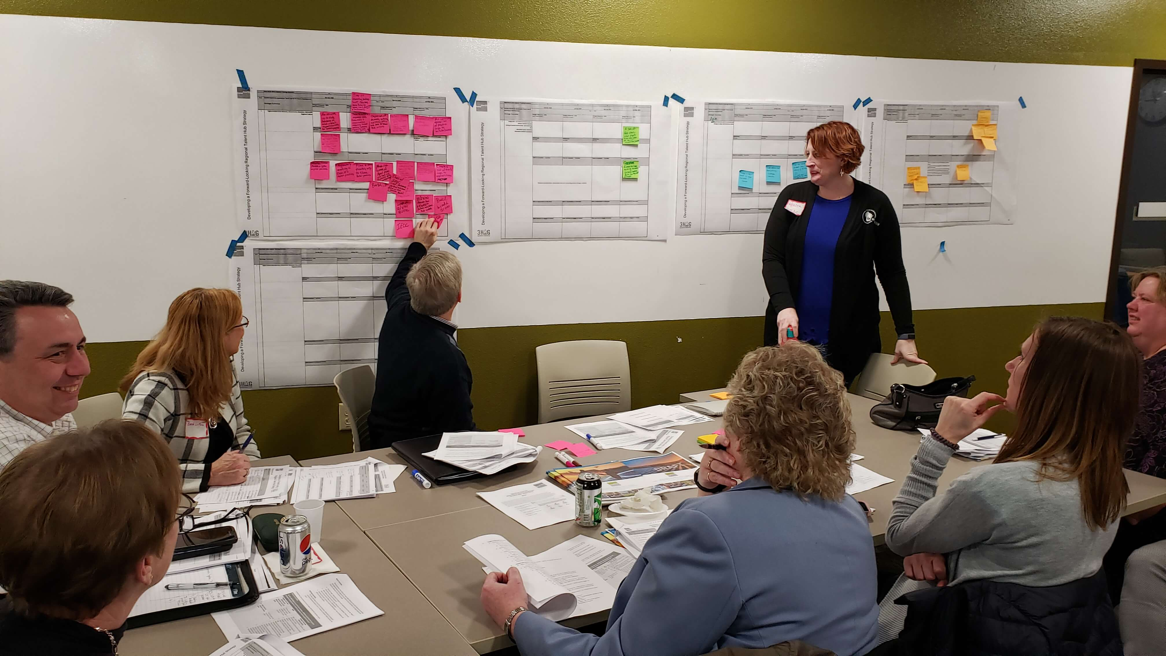 Team near whiteboard planning meeting or seminar