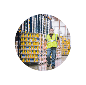 Man in warehouse in a white circle gear.