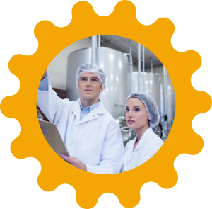 Man and woman in white lab coats inside a yellow gear